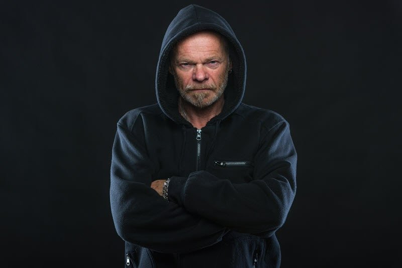 Angry man with arms folded