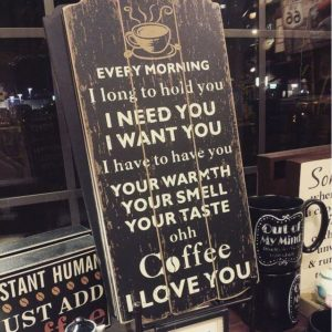 Store sign with a poem addressed to coffee