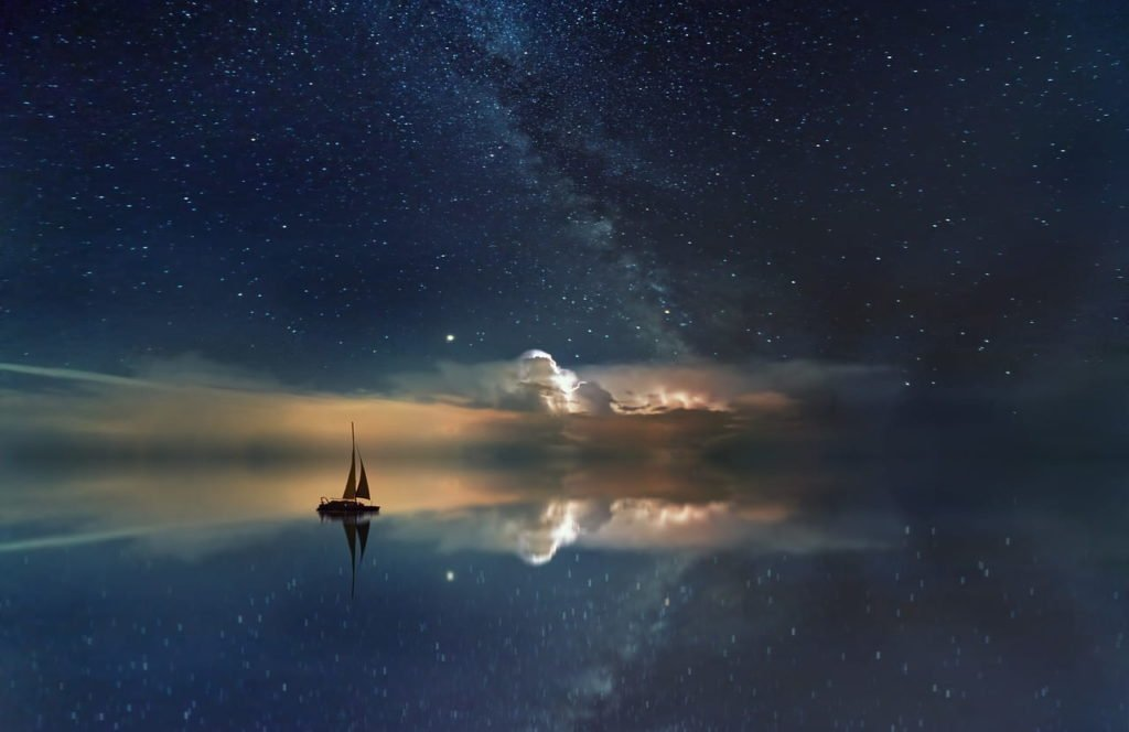Image of a sailboat against a starry background